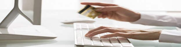 Woman shopping using computer and credit card .indoor.close-up